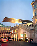 AUSTRIA, Vienna, people standing outside the Albertina Museum at dusk