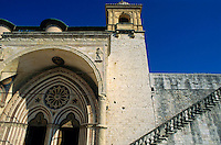 Gothic-style entrance to the Basilica of San Francesco d'Assisi in Assisi, Italy.