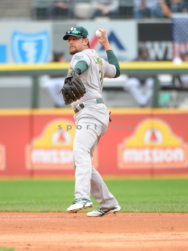 Oakland A's Jed Lowrie (8) during a game against the Chicago White Sox on September 11, 2014 at US Cellular Field in Chicago, IL. The Sox beat the A's 1-0.