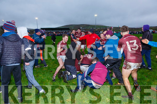 Piarsaigh na Dromoda players and supporters celebrate on the final whistle of the Walsh's Super Valu Senior Foot Ball Final Replay in Ballinskelligs on Saturday.