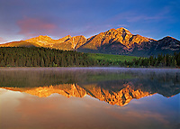 sunrise on Pyramid Mountain at Pyramid Lake<br /> Jasper National Park<br /> Alberta<br /> Canada