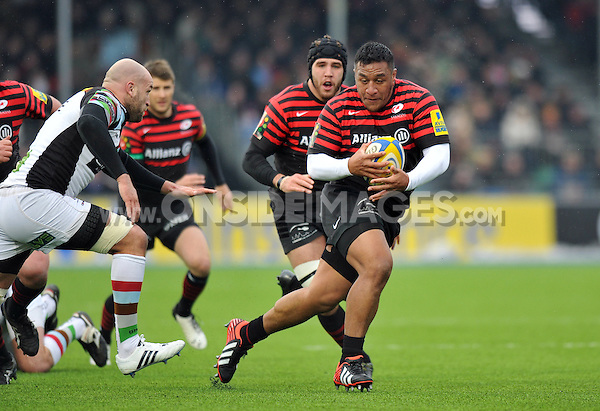 Mako Vunipola goes on the attack. Aviva Premiership match, between Saracens and Harlequins on March 24, 2013 at Allianz Park in London, England. Photo by: Patrick Khachfe / Onside Images