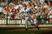 Houston Astros second baseman Craig Biggio (7) heads to second base during the Major League Baseball game against the Pittsburgh Pirates on August 13, 2005 at Minute Maid Park in Houston, Texas. The Pirates defeated the Astros 1-0. (Andrew Woolley/Four Seam Images)