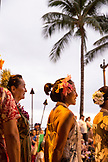 USA, Oahu, Hawaii, hula dancers perform for tourists at Waikiki Beach in Honolulu
