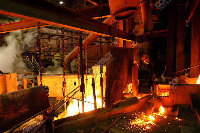 A worker oversaw the run of molten copper in the smelting section of the copper factory of the company Norilsk Nickel in the city of Norilsk, a vital metallurgical industrial city in Russia's Artic north. June 15, 2007