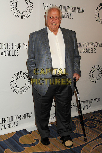 TOMMY LASORDA.The Paley Center for Media Honors Mary Hart and Al Michaels at its 2010 Annual Los Angeles Gala: Salute to Excellence held at the Beverly Wilshire Hotel, Beverly Hills, California, USA..November 30th, 2010.full length white grey gray suit jacket cane foot injury wound.CAP/ADM/BP.©Byron Purvis/AdMedia/Capital Pictures.