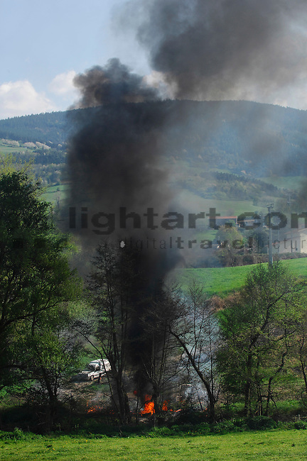 Illegal burning of trash, near St. Chamond, south-east of Lyon, Loire, France.