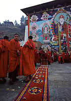 Monks in front at Tongrol (huge tangka exhibited once a year, in March-April),Shungdrei ceremony at the Paro Teschu festival, Paro Dzong Monastery, Paro Valley, Bhutan