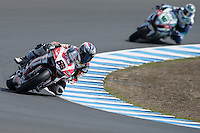 Ayrton Badovini (ITA) riding the Ducati Panigale 1199R (86) of the Team Ducati Alstare rounds turn 6 during a qualifying session on day one of round one of the 2013 FIM World Superbike Championship at Phillip Island, Australia.