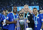 Leicester's Wes Morgan, Kasper Schmeichel and Danny Simpson celebrate with the trophy during the Barclays Premier League match at the King Power Stadium.  Photo credit should read: David Klein/Sportimage