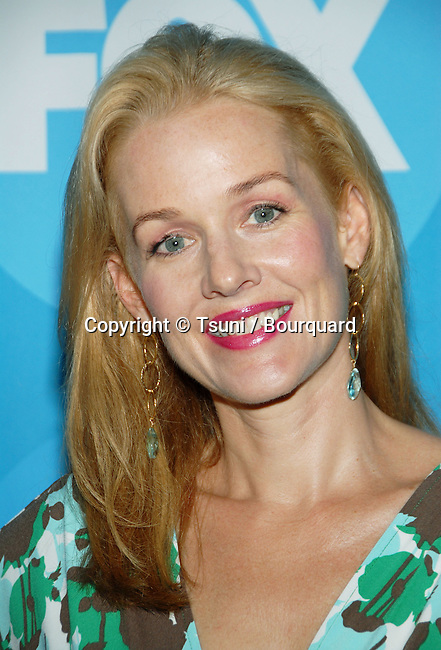 Penelope Ann Miller arriving at the FOX tca Summer party at the Ritz Carlton In Los Angeles. July 25, 2006.<br /> <br /> eye contact<br /> headshot<br /> smile