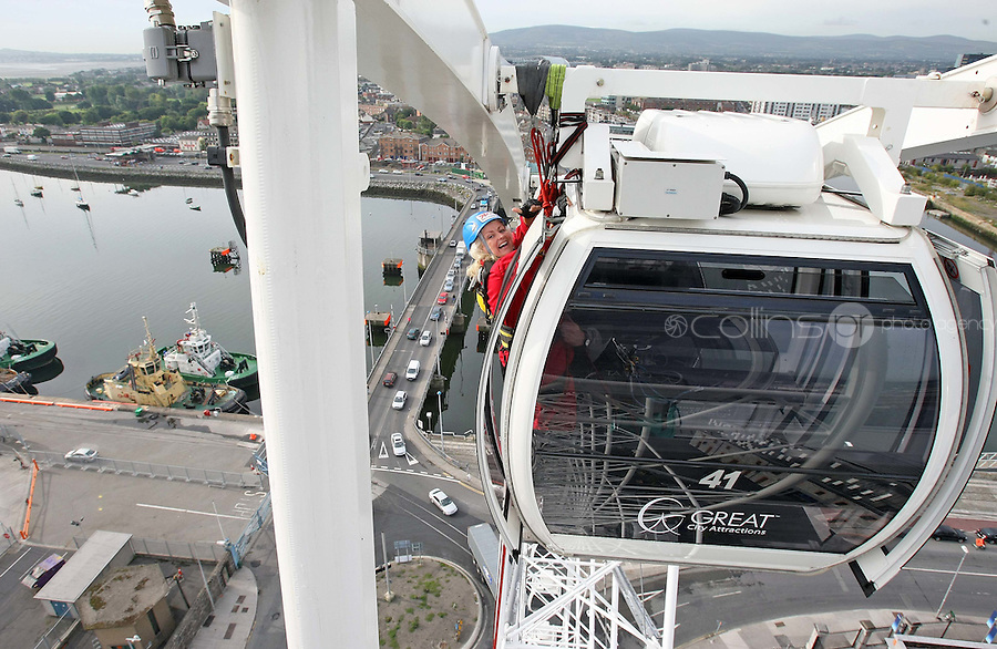 25/08/'10 Teena Gates, Head of News at 98FM pictured  at the Wheel of Dublin at the O2 this morning abseiling the 60 meters down from the top of the Wheel. After climbing her own personal mountain, recovering from illness, chronic back pain and loosing 10 stone in 12 months, Teena is heading to Mount Everest Base Camp this October as part of a celebrity fundraiser for the Hope Foundation and street kids in Calcutta....Picture Colin Keegan, Collins, Dublin.