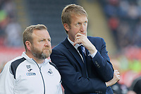 (L-R) Billy Reid, assistant manager for Swansea and Swansea City manager Graham Potter stand on the touch line during the Sky Bet Championship match between Swansea City and Rotherham United at the Liberty Stadium, Swansea, Wales, UK. Friday 19 April 2019
