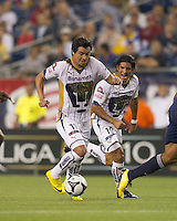 Pumas UNAM forward Juan Carlos Cacho (11) dribbles. The New England Revolution defeated Pumas UNAM in SuperLiga group play, 1-0, at Gillette Stadium on July 14, 2010.