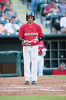 Oklahoma City RedHawks second baseman Ronald Torreyes (5) walks to the plate during the Pacific League game against the Colorado Springs Sky Sox at the Chickasaw Bricktown Ballpark on August 3, 2014 in Oklahoma City, Oklahoma.  The RedHawks defeated the Sky Sox 8-1.  (William Purnell/Four Seam Images)