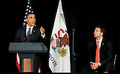 United States President Barack Obama (L) delivers remarks for Democratic U.S. Senate Candidate Alexi Giannoulias (R) at a fund raiser at the Palmer House in Chicago, Thursday, August 5, 2010. .Credit: Jeff Haynes - Pool via CNP