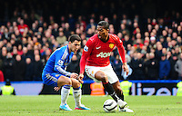 Eden Hazard of Chelsea watches Antonio Valencia of Manchester United