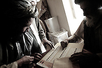 Afghan villagers give  suggetions and talk among eachother while going through the voting process in the village of Tsenan, Dey Chapon district, zabul province, Afghanistan on september 18 2005..More than 5000 villagers from the Dey Chapon valley were registerd to vote for the parlamentar elections. about 800 actually reached the pole and voted. it's a great success for this district in Zabul, considered by the US military the most taliban populated in the country. for the 2004 presidential elections only 34 aghans from this district voted. 31 of them were from the afghan national army and afghan national police.