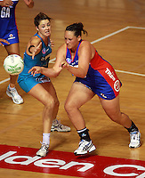20.03.2010 Mystics Catherine Latu and Thunderbirds Sharni Layton in action during the ANZ Champs Netball match between the Mystics and Thunderbirds at Trusts Stadium in Auckland. Mandatory Photo Credit ©Michael Bradley.