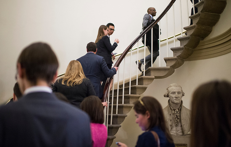 UNITED STATES - JANUARY 20: Congressional press aides head to Statuary Hall after watching President Barack Obama deliver his State of the Union address on monitors in the Crypt in the Capitol on Tuesday, Jan. 20, 2015. (Photo By Bill Clark/CQ Roll Call)