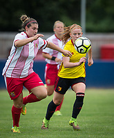 Merrick Will of Watford Ladies & Chloe Gunn of Stevenage Ladies during the pre season friendly match between Stevenage Ladies FC and Watford Ladies at The County Ground, Letchworth Garden City, England on 16 July 2017. Photo by Andy Rowland / PRiME Media Images.