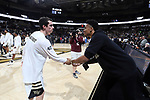 WINSTON-SALEM, NC - JANUARY 23: Wake Forest's Anthony Bilas (left) and former player and current Atlanta Hawk John Collins (right). The Wake Forest University Demon Deacons hosted the Duke University Blue Devils on January 23, 2018 at Lawrence Joel Veterans Memorial Coliseum in Winston-Salem, NC in a Division I men's college basketball game. Duke won the game 84-70.