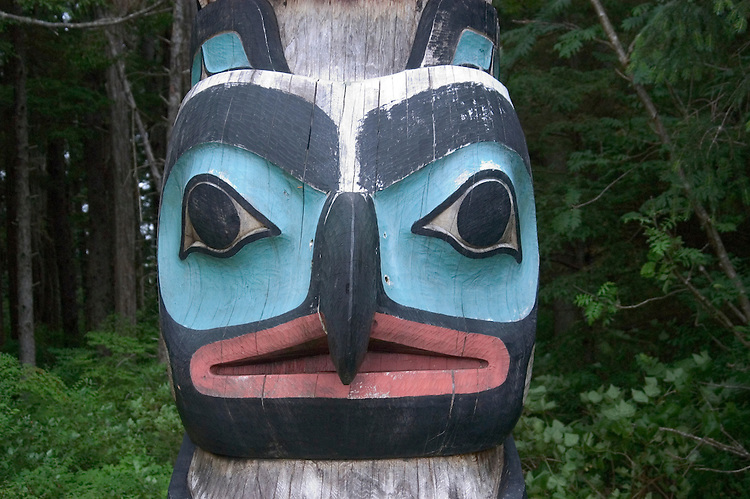 Alaska, Sitka..Totem poles and forest, example of Tongass National Forest, at the Sitka National Historic site..Photo copyright Lee Foster, 510/549-2202, lee@fostertravel.com, www.fostertravel.com.
