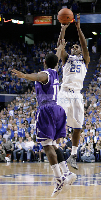 Marquis Teague shoots a three-point shot against Portland at Rupp Arena on Saturday, Nov. 26, 2011. Photo by Scott Hannigan | Staff