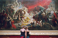 "Saint Petersburg, Russia, June 2002..The Russian Museum, with its extensive collection of Russian art, is one of the city's many world-class museums. Two visitors study Bryullov's ""The Last Days Of Pompeii"".."