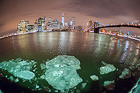 The New York skyline is seen across the East River from Brooklyn on Tuesday, February 24, 2015. Chunks of ice floating in the river due to the cold weather has caused the ferry service to be suspended on Tuesday. The East River boats are smaller than the one used on the Hudson River and would be more prone to damage. (© Richard B. Levine)