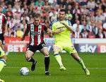 Paul Coutts of Sheffield Utd tackled by David Nugent of Derby County during the Championship match at Bramall Lane, Sheffield. Picture date 26th August 2017. Picture credit should read: Simon Bellis/Sportimage