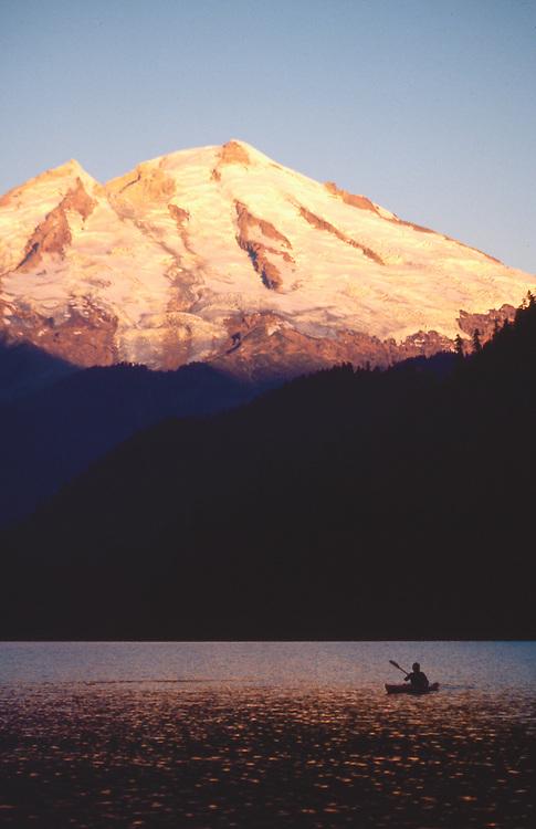 Kayaker, Mount Baker, Baker Lake, sunrise, Washington State, Cascade Mountains, Pacific Northwest, USA..