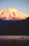 Kayaker, Mount Baker, Baker Lake, sunrise, Washington State, Cascade Mountains, Pacific Northwest, USA..
