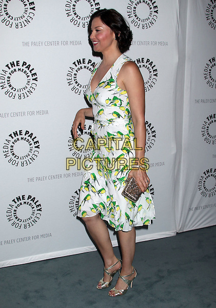 "Ashley Judd.""Missing"" Premiere Screening presented by The Paley Center for Media held at The Paley Center For Media, Beverly Hills, California, USA..April 10th, 2012.full length white green print dress bird birds gold clutch bag funny side profile .CAP/ADM/RE.©Russ Elliot/AdMedia/Capital Pictures."