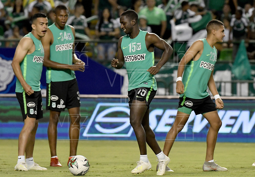 PALMIRA - COLOMBIA, 26-05-2019: Omar Duarte, Deiver Machado, Sebastian Yabur de Nacional calientan previo al partido entre Deportivo Cali y Atlético Nacional por la fecha 4, cuadrangulares semifinales, de la Liga Águila I 2019 jugado en el estadio Deportivo Cali de la ciudad de Palmira. / Omar Duarte, Deiver Machado, Sebastian Yabur of Nacional warm up prior the match for the date 4, semifinal quadrangulars,, between Deportivo Cali and Atletico Nacional of the Aguila League I 2019 played at Deportivo Cali stadium in Palmira city.  Photo: VizzorImage / Gabriel Aponte / Staff