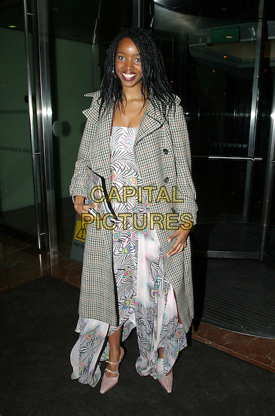JOSIE D'ARBY.Daily Mirror's Pride Of Britain Awards at the London Hilton, Park Lane.15 March 2004.full length, full-length, coat, jacket, fashion disaster.www.capitalpictures.com.sales@capitalpictures.com.© Capital Pictures.