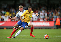 Richarlison of Brazil turns Taylor Moore (Bristol City) of England during the International match between England U20 and Brazil U20 at the Aggborough Stadium, Kidderminster, England on 4 September 2016. Photo by Andy Rowland / PRiME Media Images.