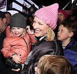 Cate Blanchett & Family attend The Ghostlight Project to light a light and make a pledge to stand for and protect the values of inclusion, participation, and compassion for everyone - regardless of race, class, religion, country of origin, immigration status, (dis)ability, gender identity, or sexual orientation at The TKTS Stairs on January 19, 2017 in New York City.