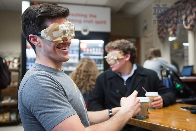 Jan. 29, 2015; Students in the Industrial Design Entrepreneurship class do an immersion exercise simulating the symptoms of tunnel vision.  (Photo by Matt Cashore/University of Notre Dame)