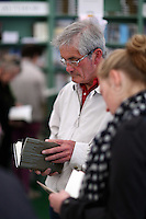 Monday 26 May 2014, Hay on Wye, UK<br /> Pictured: A man browsing through books in the festival book store.<br /> Re: The Hay Festival, Hay on Wye, Powys, Wales UK.