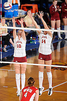 20 November 2008:  Denver setter Clare Maxwell (10) and middle blocker Jacqueline Paul (14) attempt to block a shot during the WKU 3-0 victory over Denver in the first round of the Sun Belt Conference Championship tournament at FIU Stadium in Miami, Florida.