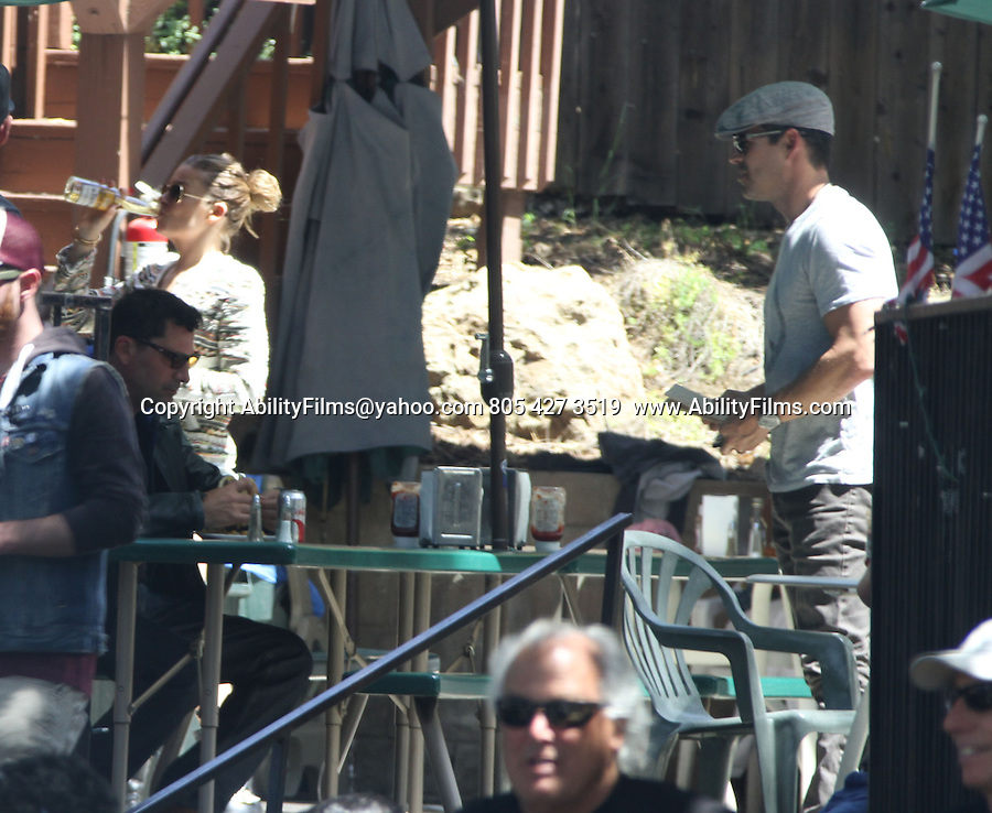 April 28th 2013    Exclusive   Sunday <br /> <br /> LeAnn Rimes &amp; Eddie Cibrian riding a Harley Motorcycle in Malibu California with friends. Eddie had on a Peace shirt &amp; Leann was wearing short dazy dukes jean shorts Trying to finish her Corona beer before they left the Rock Store. <br /> <br /> AbilityFilms@yahoo.com<br /> 805 427 3519 <br /> www.AbilityFilms.com