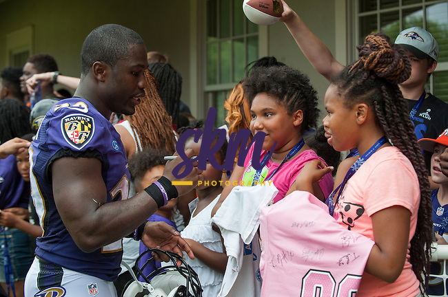 Running back, Justin Forsett, signs autographs following Day 1 of Ravens Training Camp Thursday morning at Under Armour Performance Center in Owings Mills.