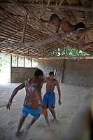 Black boys play soccer at São Raimundo Quilombo in Alcântara, Maranhão, Northeast Brazil. A quilombo is a Brazilian hinterland settlement founded by people of African origin. Most of the inhabitants of quilombos were escaped former slaves and, in some cases, a minority of marginalised non-slave Brazilians that faced oppression during colonization.