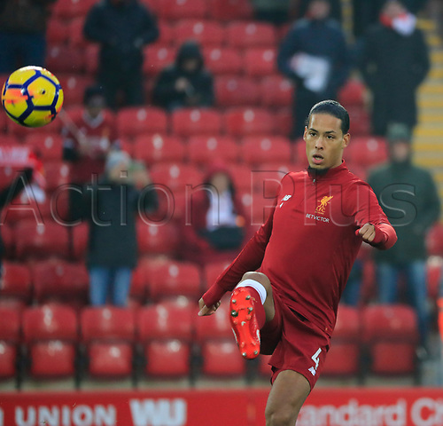 3rd March 2018, Anfield, Liverpool, England; EPL Premier League football, Liverpool versus Newcastle United; Virgil van Dijk of Liverpool warms up for the game