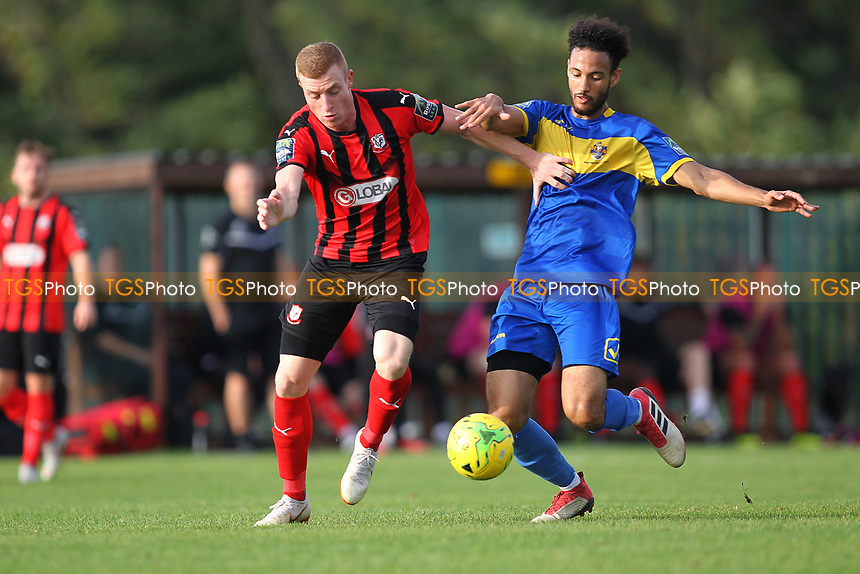 Sam Bantick of Coggeshall and Nathan Okoye of Romford during Romford vs Coggeshall Town, Bostik League Division 1 North Football at Rookery Hill on 13th October 2018