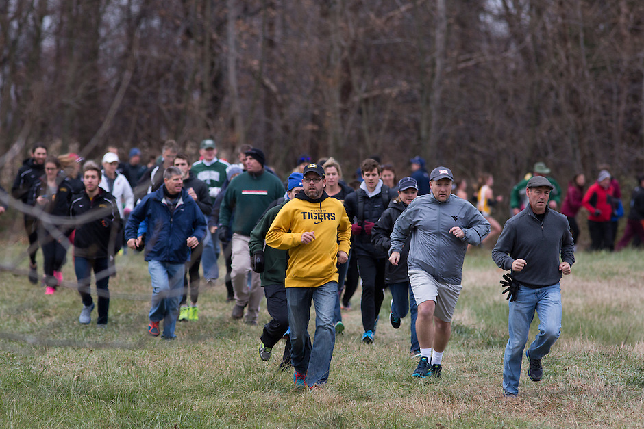 Fans scamper across an open area between loops of the course to catch another glimpse of the women's race runners during the NCAA Cross Country Championships in Terre Haute, Ind. on Saturday, Nov. 22, 2014. (James Brosher, Special to the Denver Post)