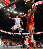 Virginia guard Jontel Evans (1) shoots a basket during the game against Clemson Thursday in Charlottesville, VA.