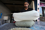 """A Palestinian man bakes traditional bread """"Taboon"""", in Gaza city, on September 22, 2019. Photo by Mahmoud Ajjour"""