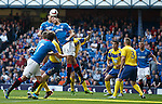Jon Daly gets his head to the ball before Bilel Mohsni to open the scoring for Rangers